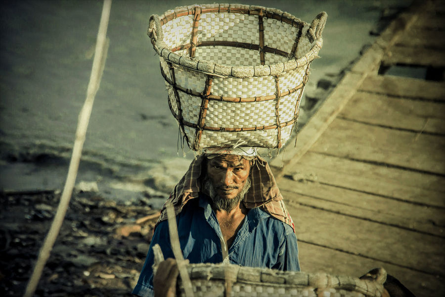 a worker (daily basis) in Mjahir ghat Ctg Bangladesh Day Labourers EyeEm Masterclass EyeEm Gallery Happiness Labourer Life Men At Work  Peopl Of Bangladesh Riverside Working Hard Eye4photography  Eye4thestreets Livelihood Outdoors People People Photography Poeple And Places Porter Portrait Real People Slavery Still Exists Street Streetphotography Workers At Work