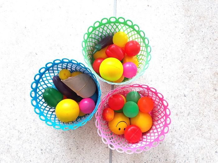 High angle view of multi colored balls in baskets
