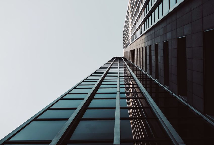 - A = ARCHITECTURE - EyeEm Best Edits Check This Out Office Building Architecture_collection Office Building Architecture Architecture Built Structure Building Exterior Building Low Angle View Sky Tall - High Clear Sky City Glass - Material Copy Space Outdoors Window Day
