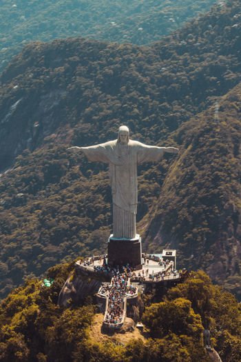 Jesus statue against mountains