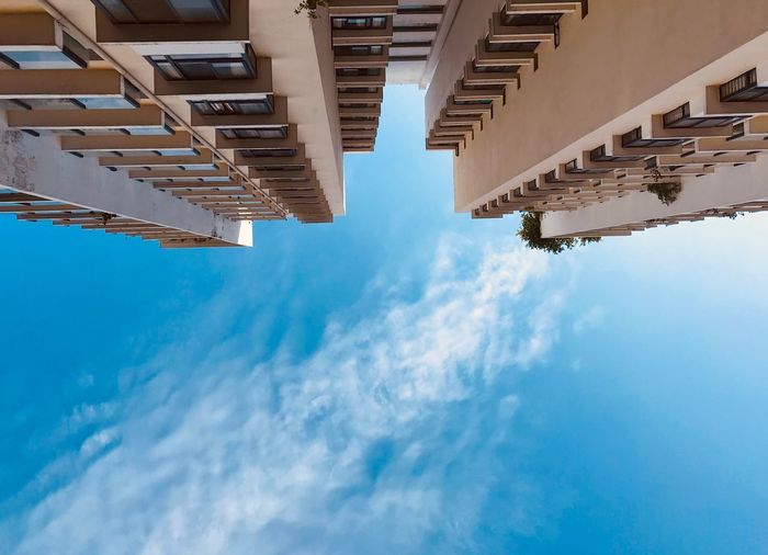 Looking up to the beautiful blue sky Directly Below Skyscraper Tall - High Outdoors City Blue Building Low Angle View Day Nature No People Building Exterior Built Structure Architecture Cloud - Sky Sky EyeEm Best Shots EyeEm Selects Residential District Pattern