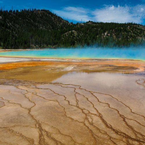 Scenic View Of Grand Prismatic Spring And Mountain At Yellowstone National Park