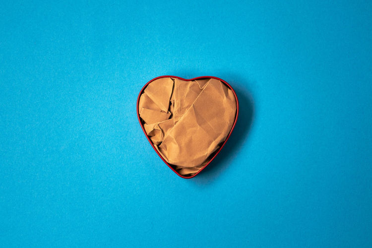 High angle view of heart shape on blue surface