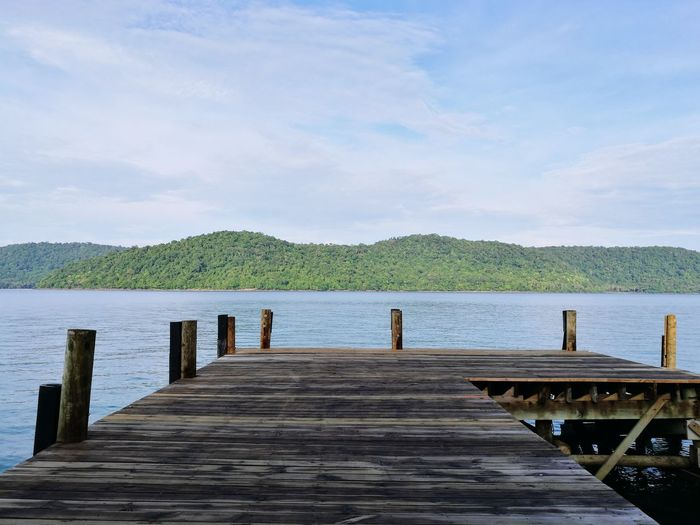 Endless. Pier Wood - Material Lake Sky Landscape Tranquility Water Vacations Summer No People Beach Travel Destinations Scenics Nature Tree Vacations