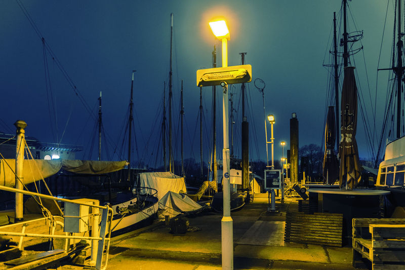 LittleNightHarbour Blue City Commercial Dock Development Electric Light Empty Finkenwerder Illuminated Kutterhafen Lanterns Lighting Equipment Mode Of Transport Night Night Photography No People Outdoors Railing Sailboat Sky Yellow
