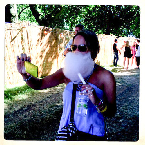Candy Floss Carefree Casual Clothing Childhood Friendship Front View Happiness Holding Leisure Activity Lifestyles Looking At Camera Party Time Person Perspective Portrait Real People Selfie Madness Sitting Smiling Soho House Festival Sunglasses Young Adult Young Women