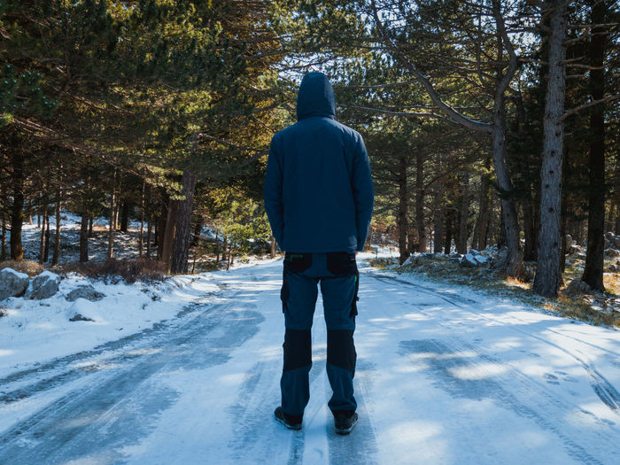 Man standing on snow covered frozen road Croatia Frozen Road Travel Walk Biokovo Casual Clothing Clothing Cold Cold Temperature Covering Day Forest Leisure Men Mountain Nature One Person Outdoors Rear View Scenics Snow Tree Warm Clothing Winter