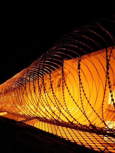 Barbed Wire Barbed Wire Fence Illuminated Low Angle View Night No People Orange Color Outdoors Projecting Points Sky Stacheldraht Stacheldrahtzaun