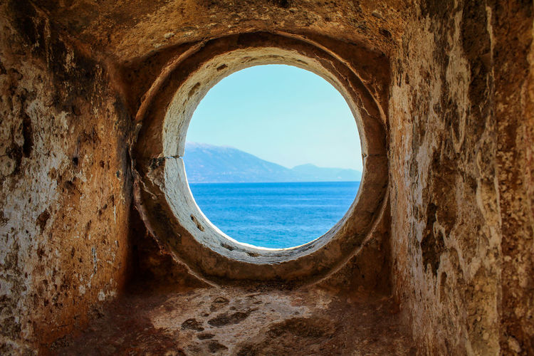 Scenic view of sea seen through hole