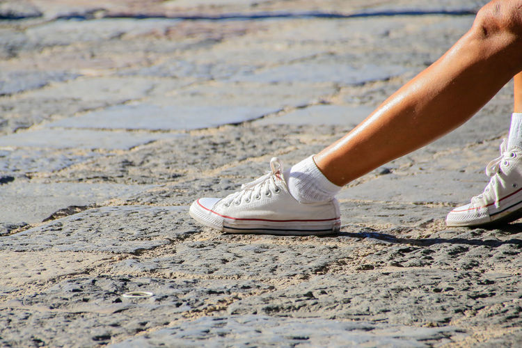 stylish legs Brown Legs City Life Close-up Day Getting Away From It All Gym Shoes Human Foot Joggers Leg Legs Leisure Activity Long Legs Outdoors Person Plimsoles Pumps Runners Style Tourism Training Shoes Vacations