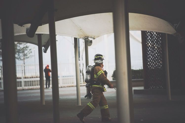 Firefighter Walking In Building