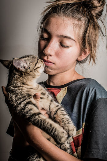 Portrait of woman with cat