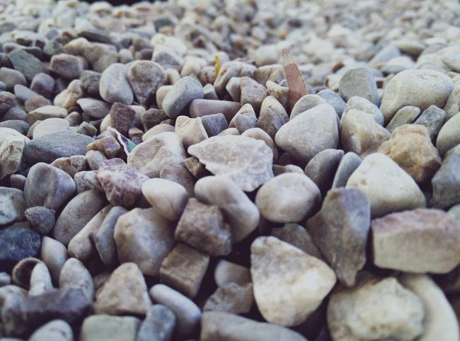 Abundance Backgrounds Beauty In Nature Close-up Day Detail Focus On Foreground Full Frame Ground Heap Large Group Of Objects Natural Pattern Nature No People Outdoors Pebble Selective Focus Stone Stone - Object Surface Level Tranquility