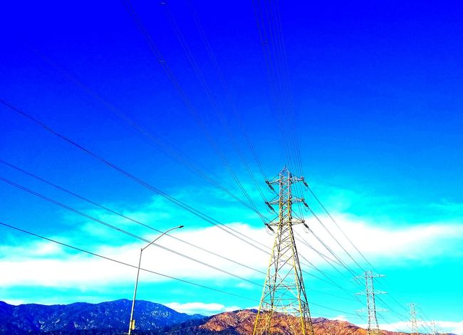 Blue Sky Connection Low Angle View Electricity  Nature No People Power Supply Motion Day Clear Sky Outdoors Technology Tree Beauty In Nature Close-up Mountain Range Shadow And Light Still Life Photography Copy Space Nature Cloud - Sky Electricity Pylon Check It Out Adapted To The City