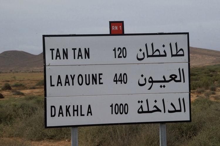 Cycling through the Western Sahara - roads around Tan Tan/ Al-Ajoen Al-Ajoen Tan Tan West Africa Africa Communication Dakhla Direction Guidance Road Sign Sahara Signboard Text Western Sahara