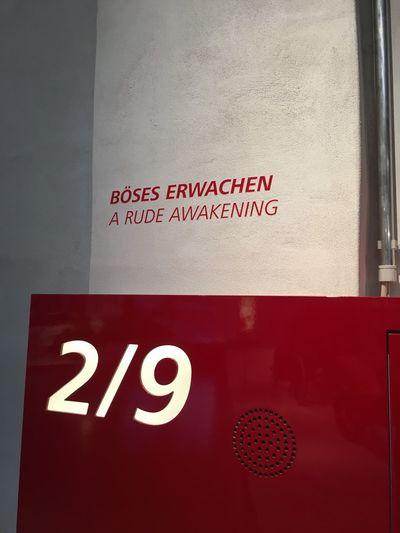 Close-up of warning sign on wall