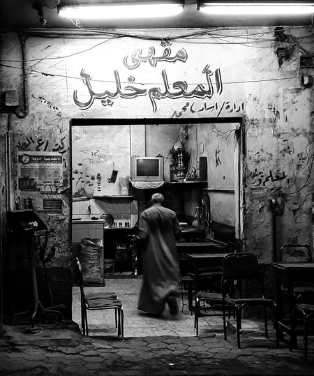 Local cafe in uperegypt.. One Person Arts Culture And Entertainment One Man Only Only Men Adult Adults Only Working Real People Day Standing Men Mobilephotography Lifestyles Built Structure Streetphotography Shadow Outdoors Uper Egypt Photooftheday Poor Man Black Color Working Food Adult City