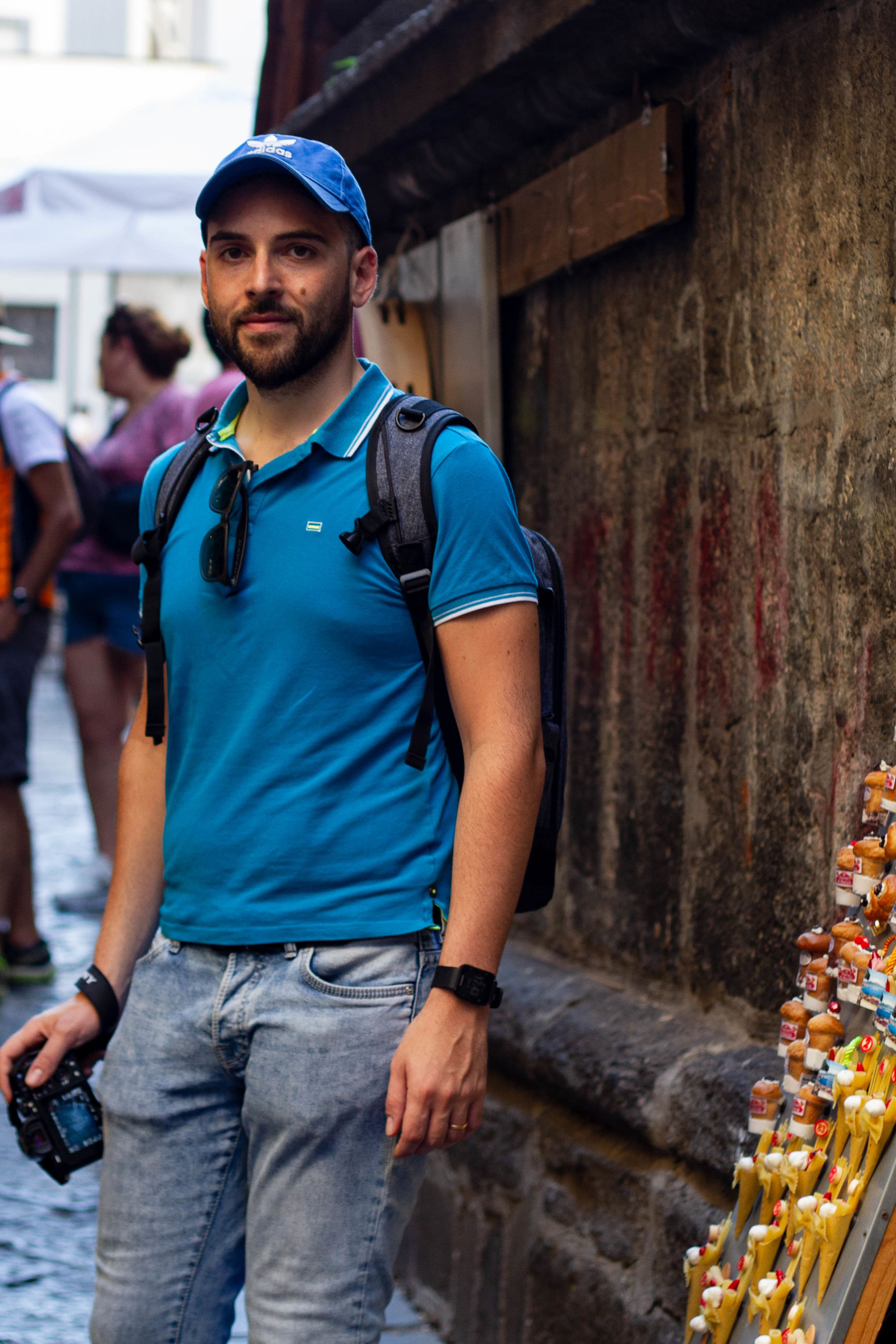 young adult, three quarter length, one person, young men, standing, real people, leisure activity, casual clothing, lifestyles, portrait, looking at camera, focus on foreground, architecture, front view, hat, incidental people, day, built structure, outdoors