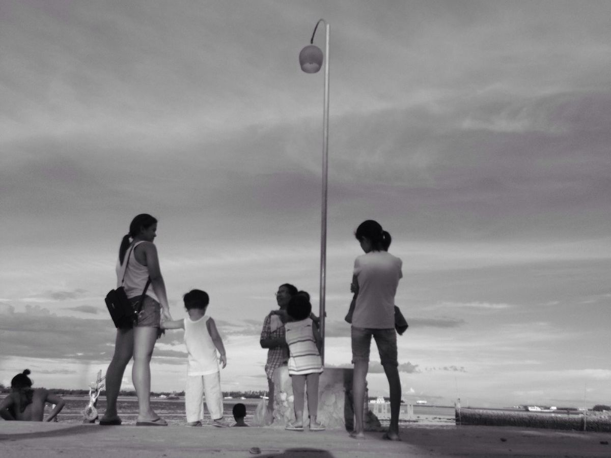 Family❤ Family Time Bonding Seaside Random People Kids Sunset Moments Chitchat Black & White Black And White Collection  Black And White Photography Street Photography Baywalk The Story Behind The Picture The Street Photographer - 2016 EyeEm Awards EyeEm Streets Every Picture Tells A Story Everyday People Everybody Street Mobile Photography Eyeem Philippines EyeEm Street Photography