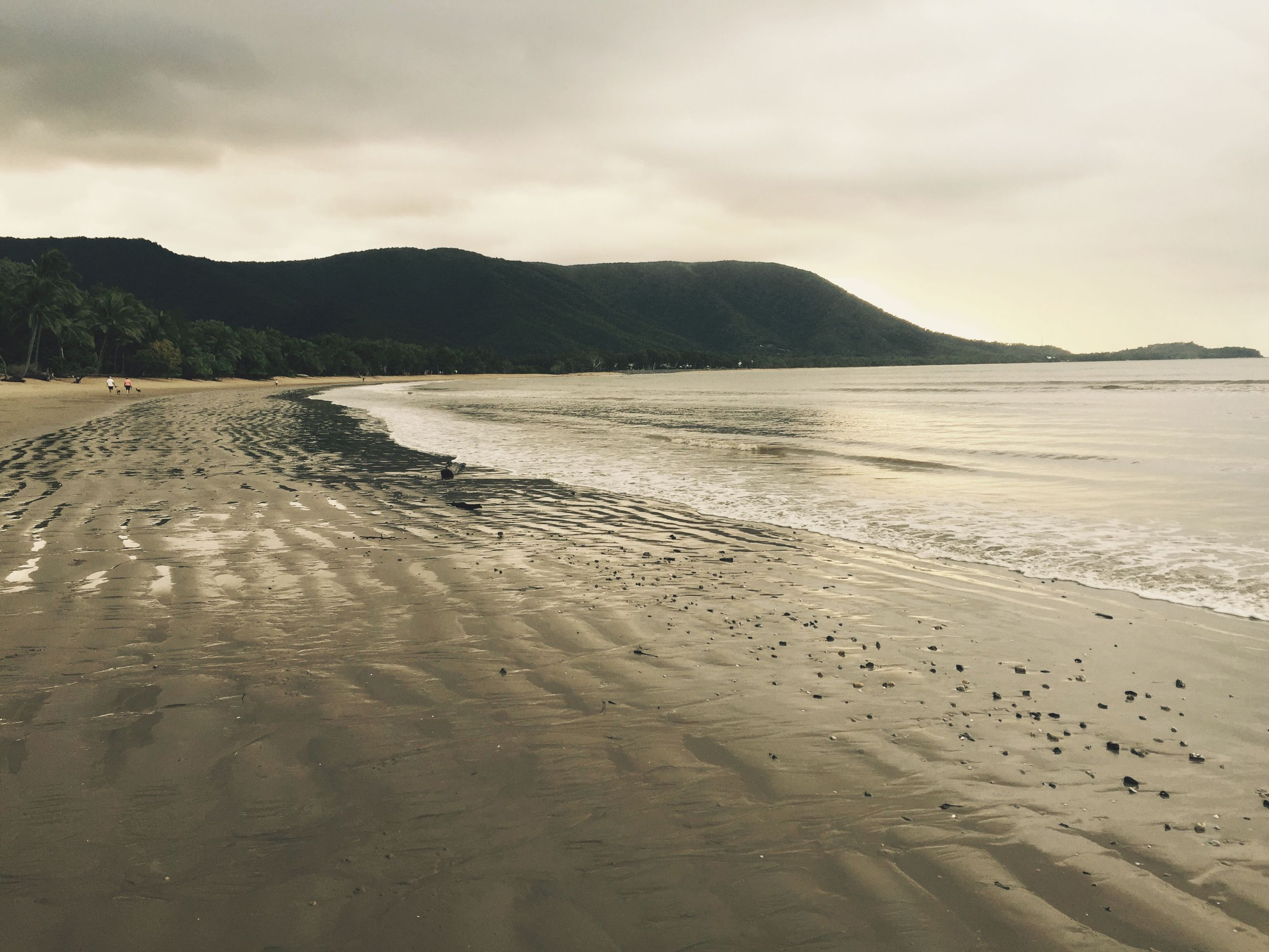 beach, sand, sky, water, sea, tranquil scene, shore, scenics, tranquility, beauty in nature, nature, cloud - sky, mountain, coastline, cloudy, footprint, idyllic, cloud, remote, incidental people