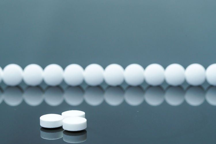 Close up of pills against gray background