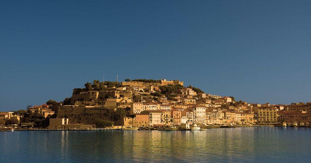 Scenic View Of Portoferraio And Sea Against Clear Blue Sky