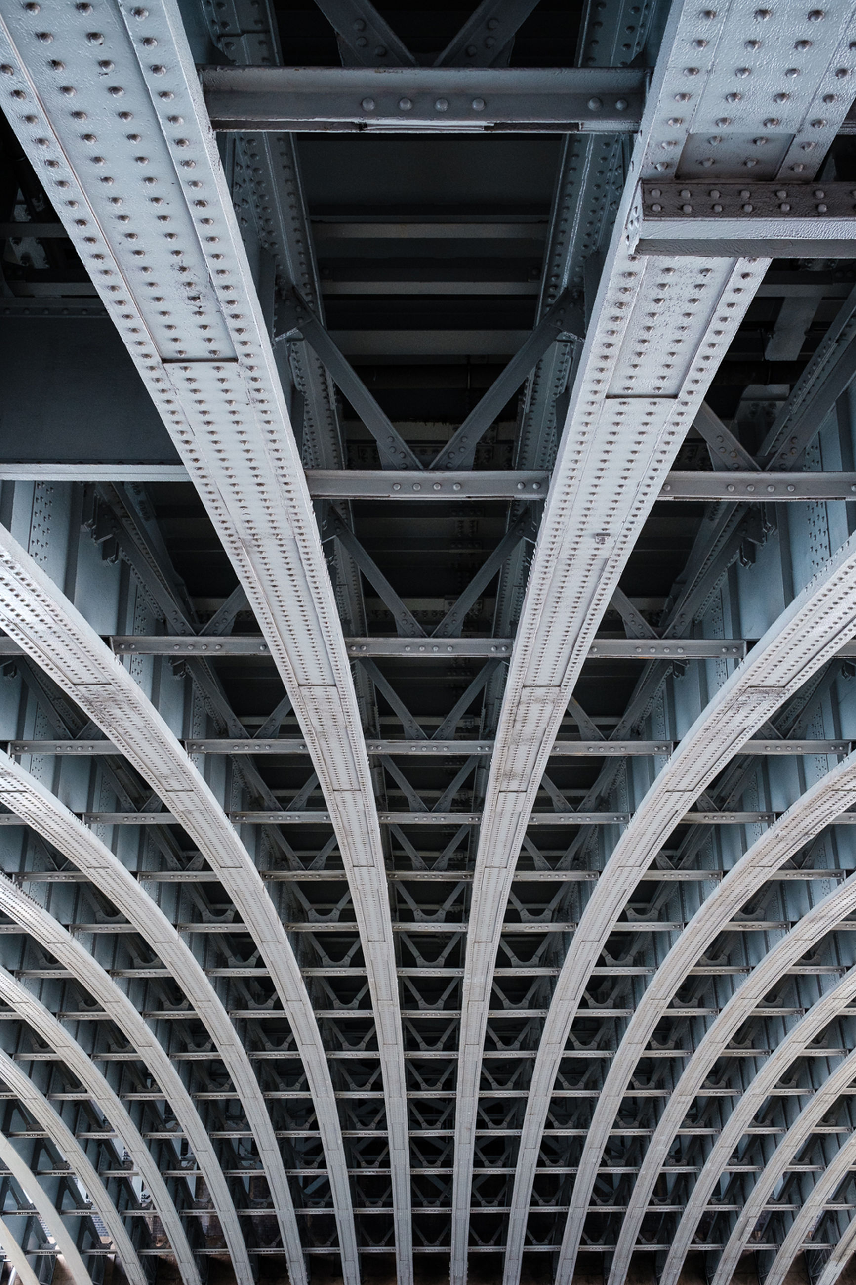 architecture, built structure, low angle view, architectural feature, engineering, modern, design, no people, repetition, backgrounds, diminishing perspective, full frame, directly below, illuminated, sky