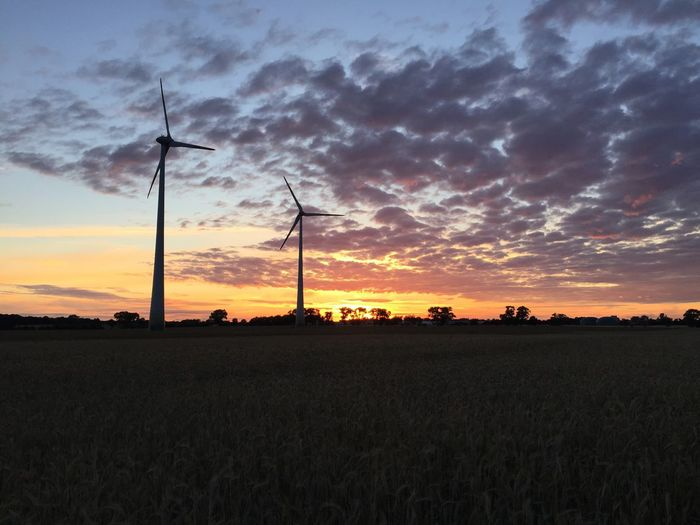 EyeEmNewHere Sunset Field Fuel And Power Generation Nature Wind Power Alternative Energy Wind Turbine Sky Environmental Conservation Beauty In Nature Rural Scene Agriculture Landscape Tranquility Tranquil Scene Renewable Energy Scenics No People Cloud - Sky Silhouette iPhone