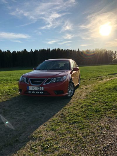 SAAB 9-3 in the sun Nevs Red 93 Saab Mode Of Transportation Sky Transportation Plant Cloud - Sky Sunlight Nature Field Land Car Grass Sunset Motor Vehicle Land Vehicle Tree Day Outdoors No People Green Color Non-urban Scene