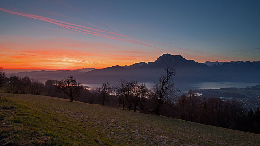 Sonnenaufgang Morgenstimmung In Den Bergen Morgenstimmung Am See Salzkammergut Berge Morgenrot Morgenröte Österreich Sky Scenics - Nature Beauty In Nature Tranquil Scene Sunset Tranquility Mountain Plant Environment Tree Landscape Non-urban Scene Idyllic Mountain Range Land Nature No People Orange Color Field Remote Outdoors