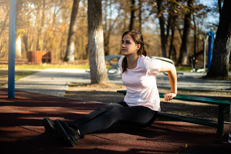 Full length of woman exercising in park