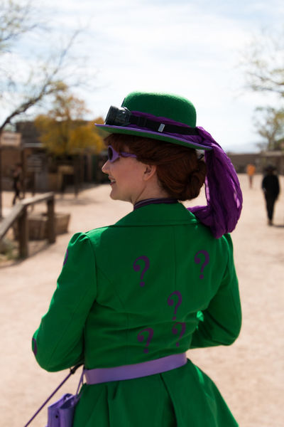 The Riddler's wife.All Dressed Up, Nowhere To Go Alone Casual Clothing Composition Convention Cosplay Feather Hat Happiness Leisure Activity Lifestyles My Perspective Old Tucson Studios Outdoor Photography Person Perspective Portrait Press-Pass Real People Smiling Standing Steam Punk The Joker Tucson Arizona  Waist Up Wild Wild West Steampunk Convention 5