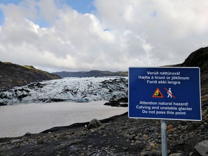 Solheimajokull Glacier Ice Sign Caution Glacier Iceland Icelandic Landscape Communication Text Guidance Sky Close-up Cloud - Sky Lagoon Glacial