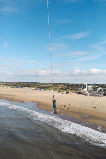 Autumn Beach Bungee Jumping Cord Day De Pier Human Body Part Nature One Person Outdoors People Pier Reuzenrad Sand Sea Sky Sunny Water Be Brave Analogue Sound