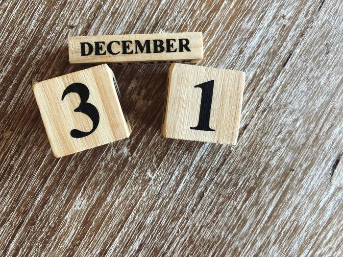 31 December on copy space Year End Text Communication Western Script No People Indoors  Close-up High Angle View Still Life Full Frame Pattern Wood - Material Number Textile Single Word Capital Letter Sign White Color Paper Backgrounds Textured