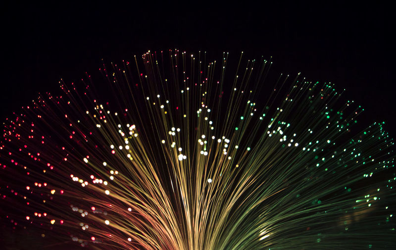 Close-up of firework display against clear sky at night