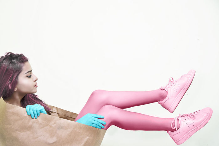 Cotton Candy Colors Concept Transgender Flag Art Artist Perspective Discoverportrait Hypebeast  EyeEm Selects Fashion Photography White Background Young Women Portrait Spraying Studio Shot Beautiful Woman Women Cleaning Protective Glove