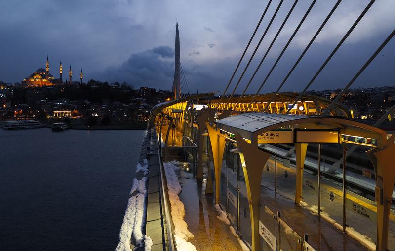 View of illuminated bridge against cloudy sky