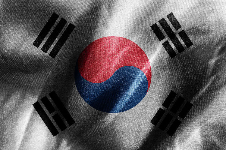 Close-up of flags against black background