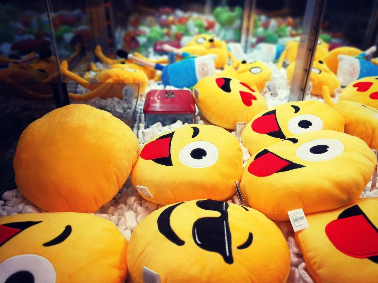 CLOSE-UP OF TOYS FOR SALE IN MARKET STALL