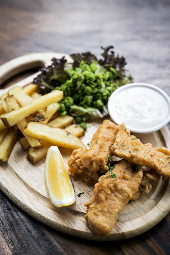 fish fingers and chips meal British Cuisine Fish And Chips Fish Fingers Modern Battered Cod Chips Close-up Day English Fish Focus On Foreground Food Food And Drink French Fries Freshness Fried Gourmet Healthy Eating Indoors  No People Plate Ready-to-eat Serving Size Table