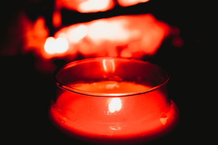 Close-up of lit candle in dark