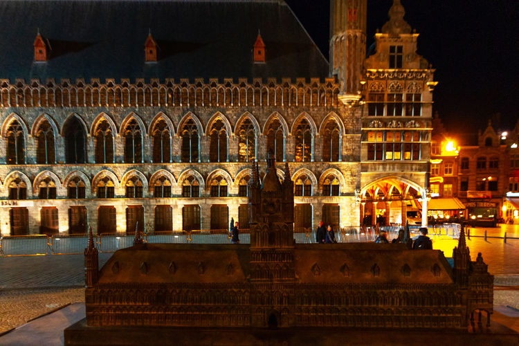 View of old building in town at night