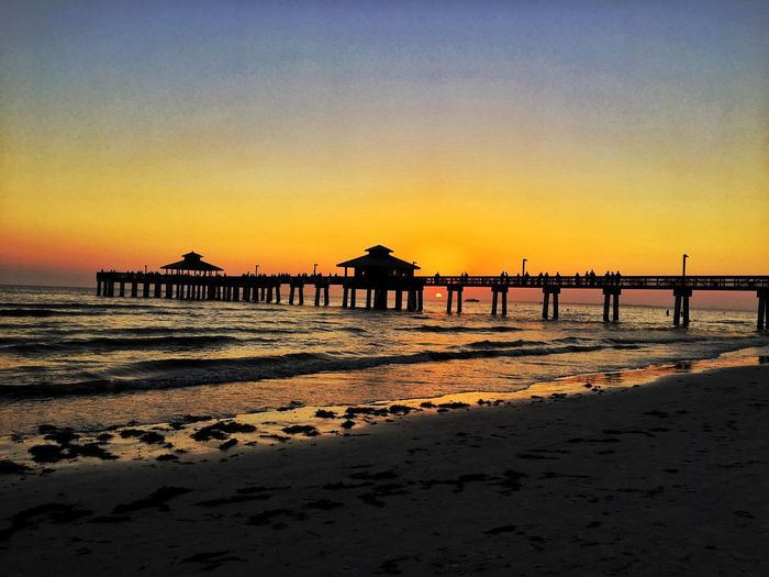 Pier Pier Florida Beauty Florida Sunset Fort Myers Beach Sunset Beach Sea Silhouette Beauty In Nature Water Tranquil Scene Shore Sand Vacations