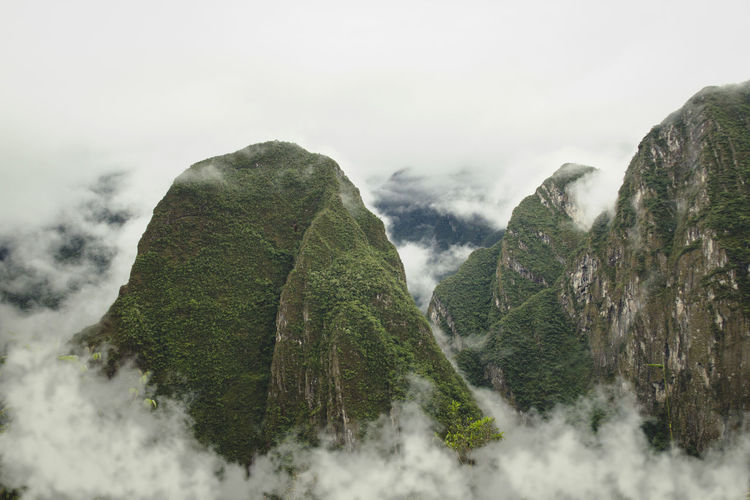 Majestic view of clouds covering green mountains at machu picchu