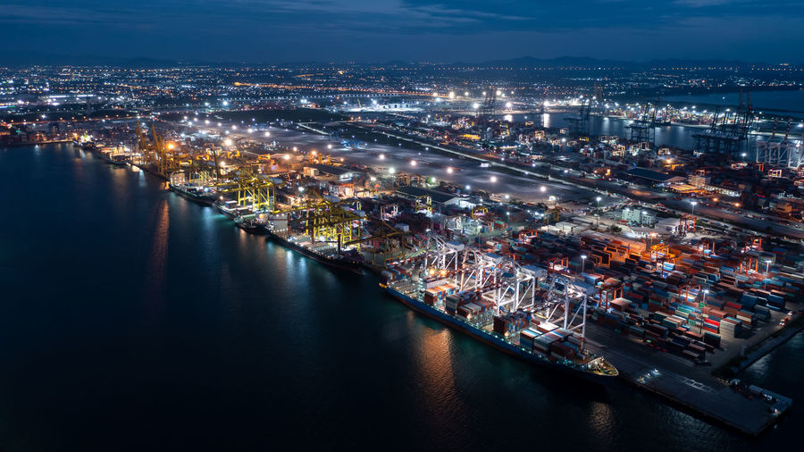 shipping port and container cargo ship  logistics transportation international on deep sea at night