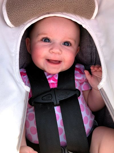 Portrait Of Smiling Baby Girl In Carriage