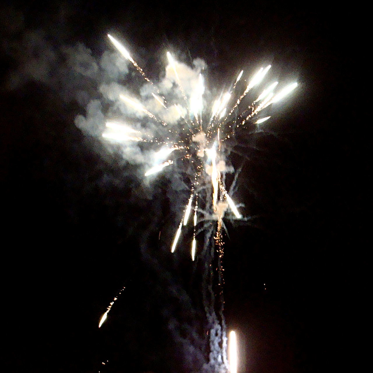 night, firework display, celebration, firework - man made object, exploding, event, arts culture and entertainment, long exposure, glowing, low angle view, illuminated, motion, sky, no people, outdoors, firework, blurred motion