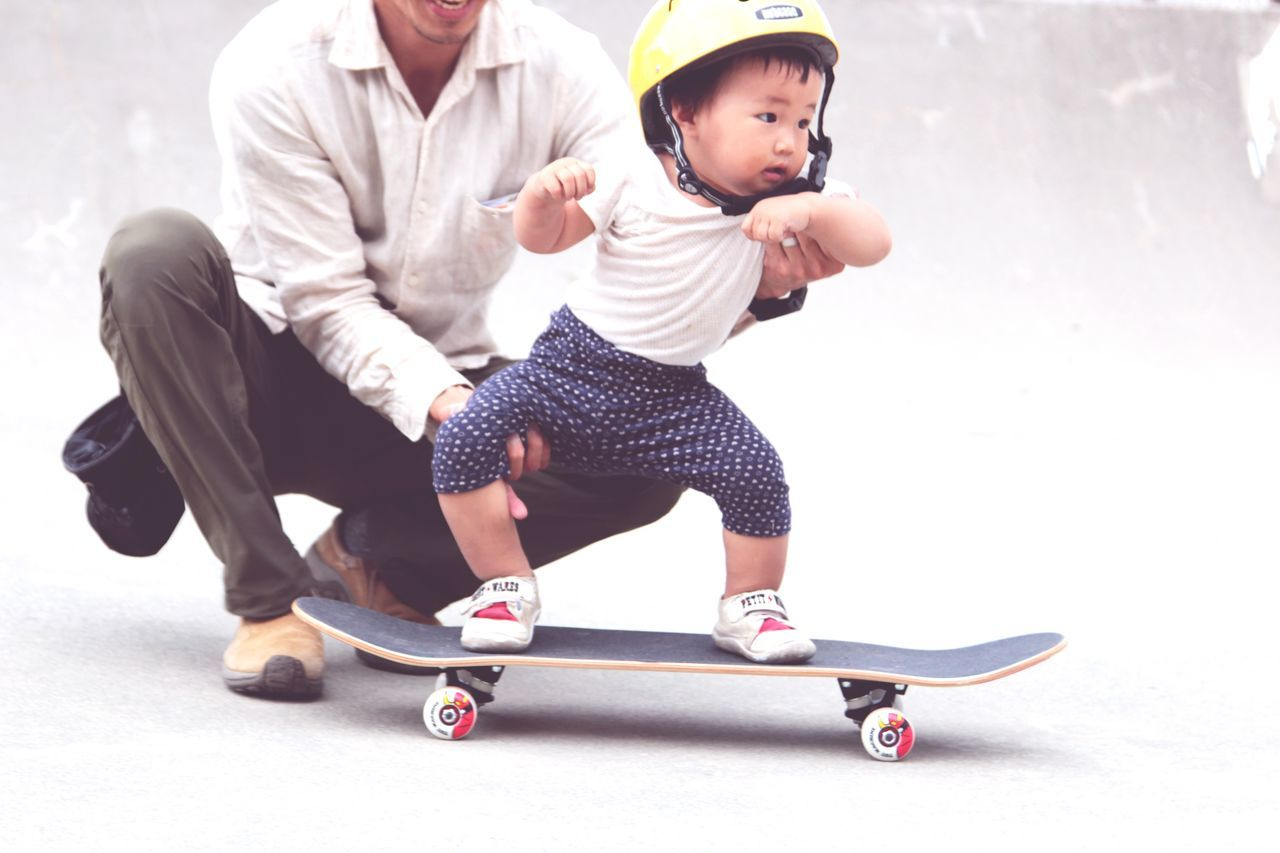 Father and baby boy on longboard
