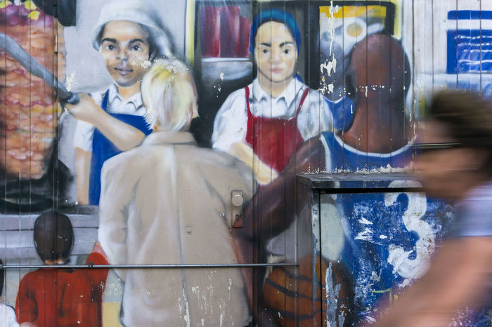 Mural on döner stand with blurred cyclist passing by in Berlin, Germany Adult Berlin Color Image Cyclist Döner Female Likeness Germany🇩🇪 Horizontal Human Representation Human Representations Motion Blur Mural No People Outdoors People Photography STAND